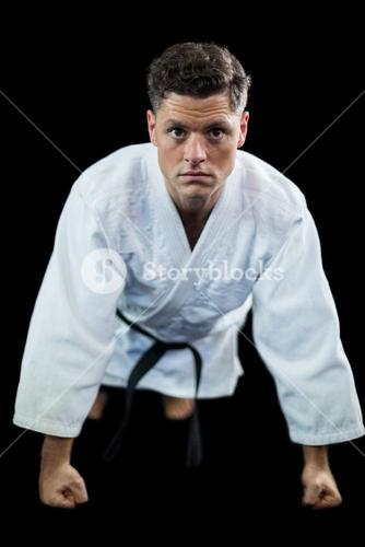 Karate player doing push-up