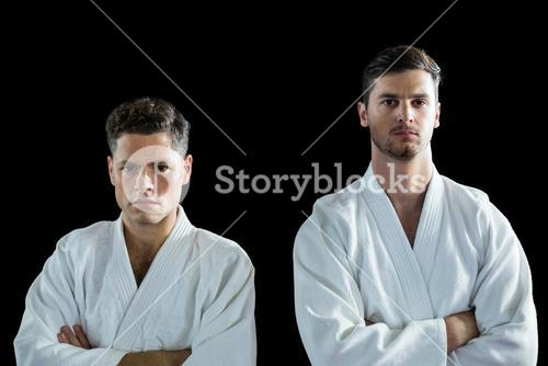 Karate players standing with arms crossed