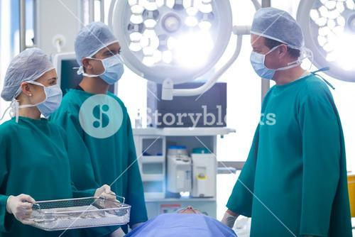 Surgeons interacting while performing operation in operation theater