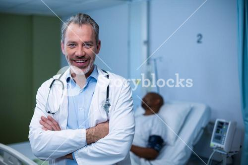Portrait of doctor standing in ward