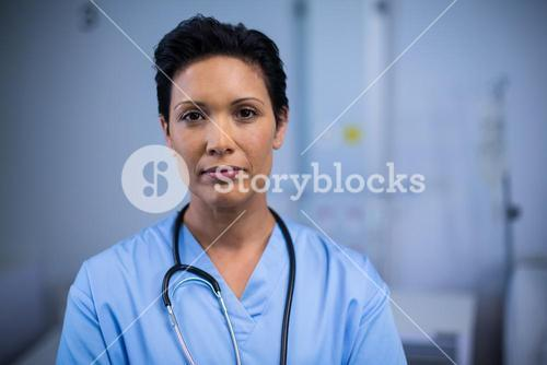 Portrait of female nurse in ward