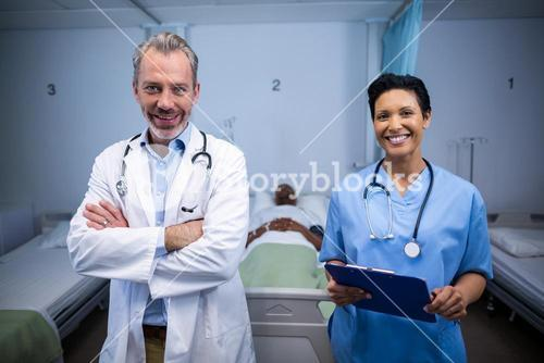 Portrait of smiling doctor and nurse in ward