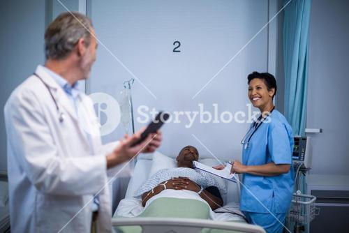 Doctor interacting with nurse in ward