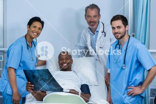 Portrait of doctor, nurse and patient in ward