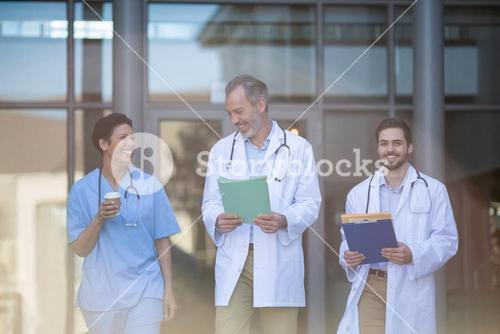 Nurse and surgeons interacting with each other