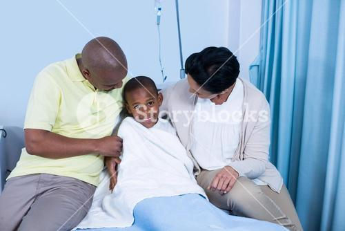 Smiling parents interacting with patient
