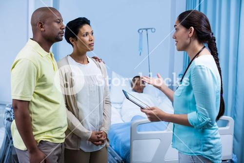 Doctor interacting with patient parents
