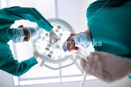 Surgeons operating in operation theater