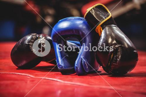 Boxing headgear and gloves in boxing ring