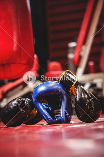 Boxing headgear and pair of gloves