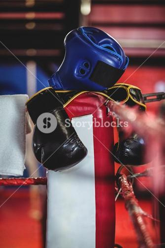 Boxing gloves, headgear and a towel kept on boxing ring