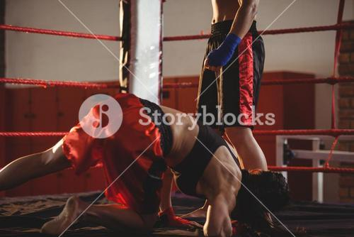 Two female boxers fighting in the ring