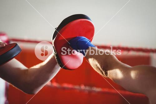 Female boxer practicing in the ring