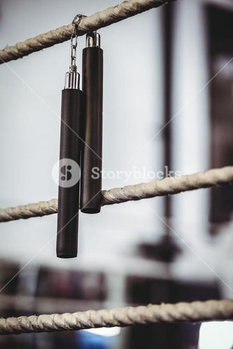 Nunchaku hanging off the ring