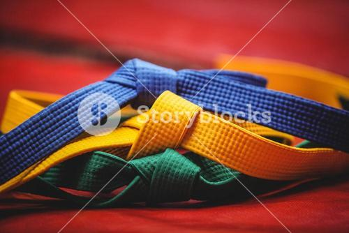 Blue, yellow and green karate belt