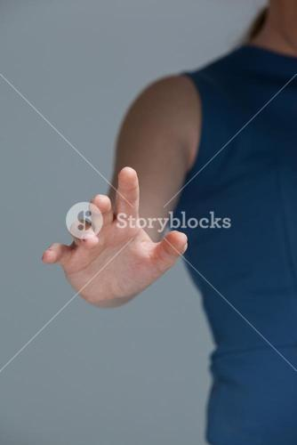 Hand of a woman touching invisible screen