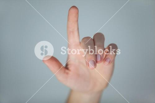 Hand of a woman pointing upwards