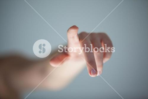 Hand of a woman touching an invisible screen
