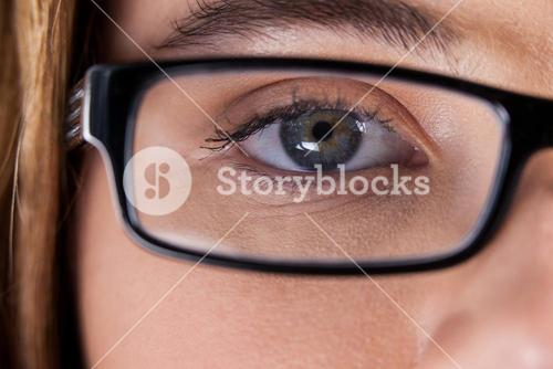 Beautiful eye of a woman wearing spectacles