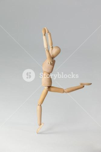 Wooden figurine exercising on floor