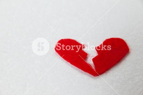 Red broken heart on white background