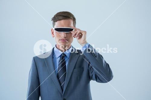 Businessman using virtual reality glasses
