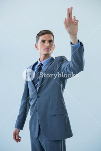 Businessman touching an invisible screen
