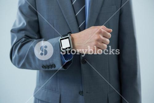 Businessman showing his smartwatch