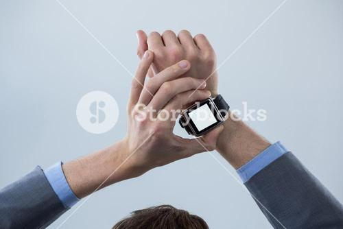 Businessmans hands checking his smart watch