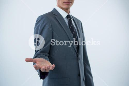 Mid section of a businessman offering a helping hand