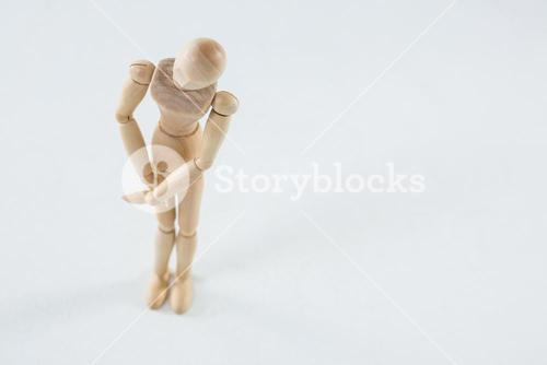 Wooden figurine with leg injured
