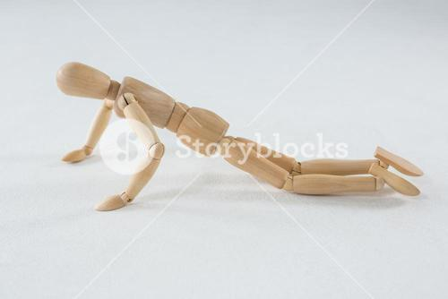 Wooden figurine doing push-up