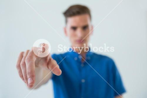 Man touching an invisible screen