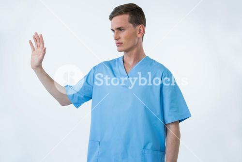 Male nurse touching an invisible screen