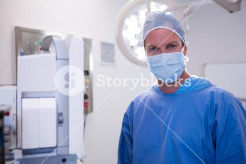Portrait of surgeon standing in operation room