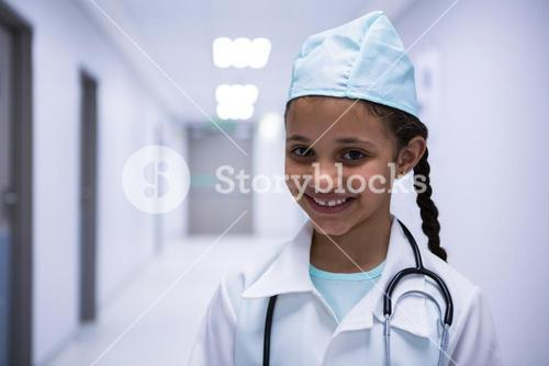 Portrait of smiling girl pretending to be a doctor