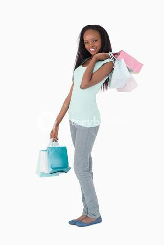 Woman with shopping on white background