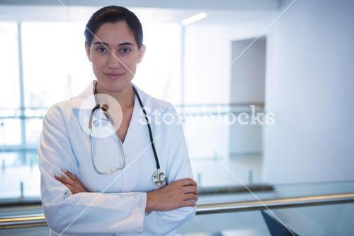 Portrait of doctor standing with arms crossed