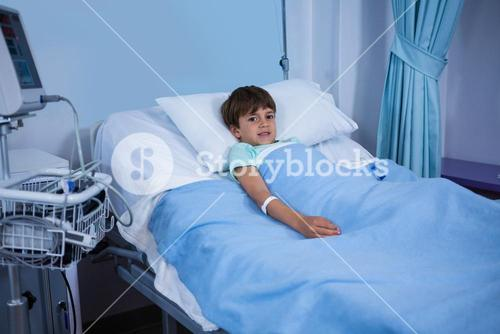 Portrait of patient resting on operation bed in ward