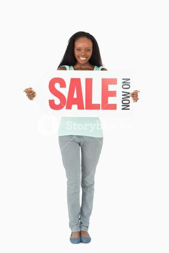 Woman holding ad on white background