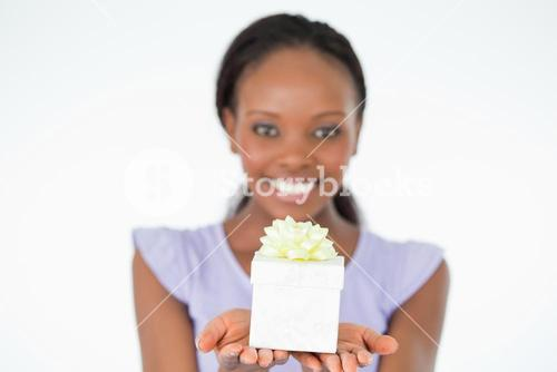 Close up of present being held by woman against a white background