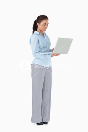 Professional woman working on laptop against a white background