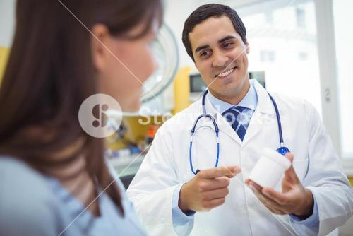 Doctor prescribing medicines to female patient