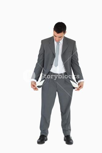 Businessman looking at empty pockets
