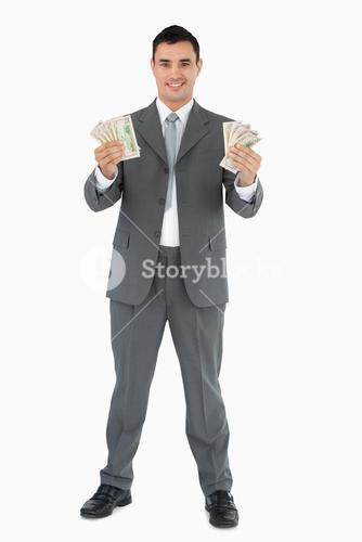 Businessman presenting banknotes with both hands