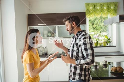 Couple having argument in kitchen