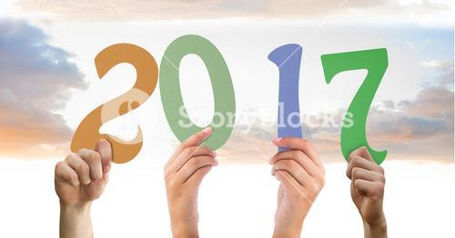 Composite image of hands holding 2017 new year sign