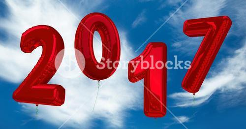 Inflatable 2017 numbers against a composite image 3D of clouds and sky
