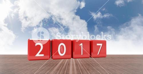 2017 in blocks against a composite image 3D of land and sky