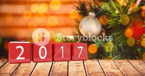 2017 in blocks on wooden plank against a composite image 3D of christmas background